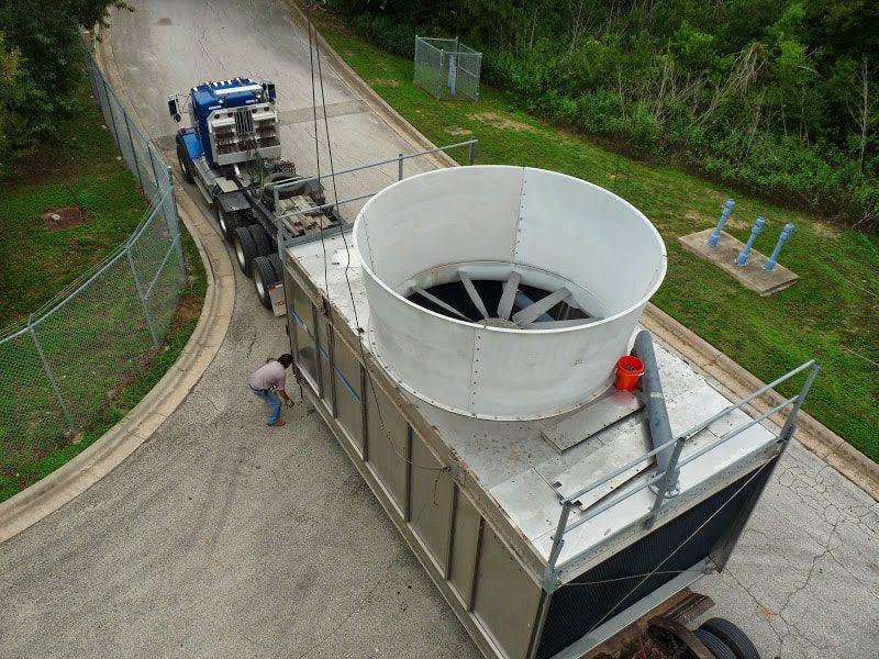 The removal of a cooling tower for a facility shutdown